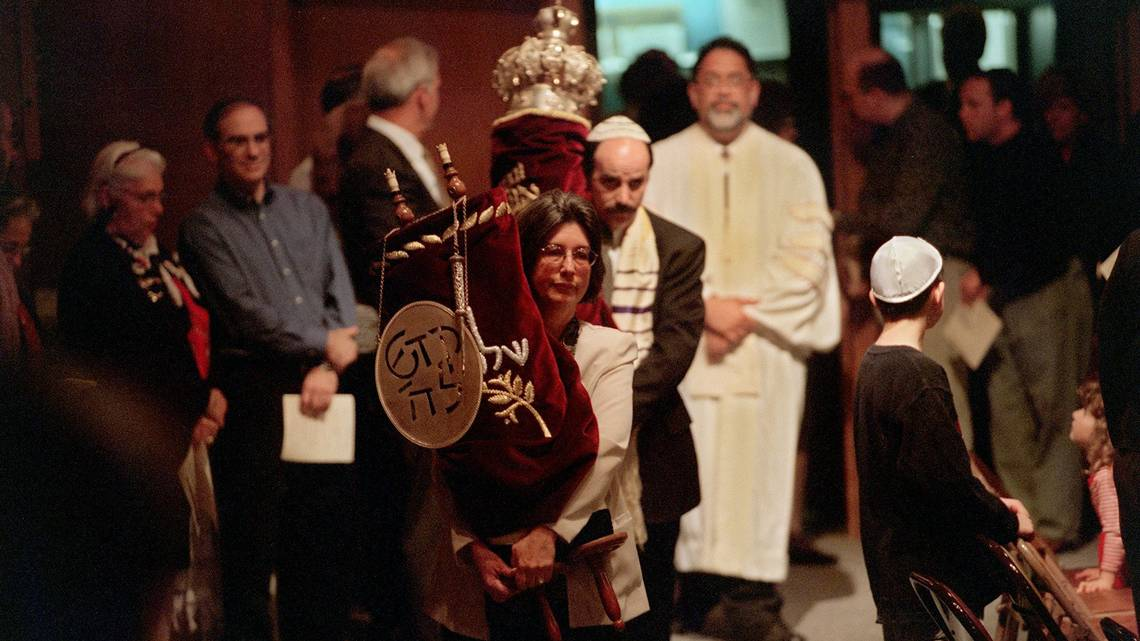 Torahs brought in to rededicate the sanctuary by congregational leaders at Congregation B'Nai Israel . (Photo by Dick Schmidt Sacramento Bee)