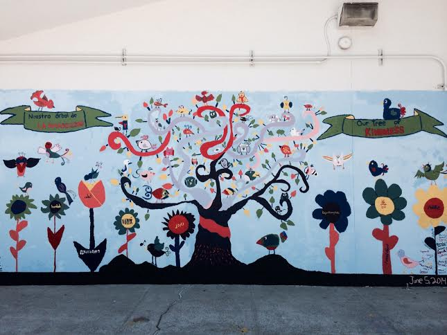 Standing opposite of the library at Grimmer Elementary School, the Kindness Tree mural serves as a reminder to all those who see it to cultivate kindness.