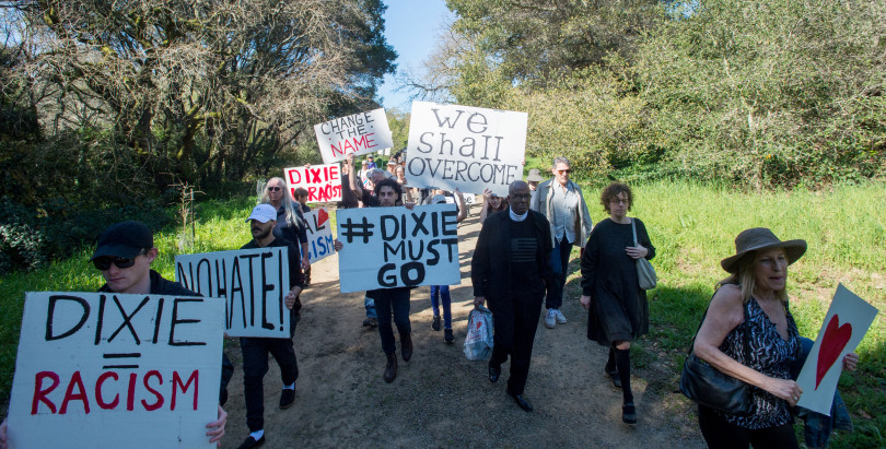 """A """"Silent Parade"""" makes its way through the Marinwood area of San Rafael, Calif. Saturday March 16, 2019 to draw attention to racial injustice and the need to change the name of the Dixie School District. (Jeremy Portje/ Marin Independent Journal)"""