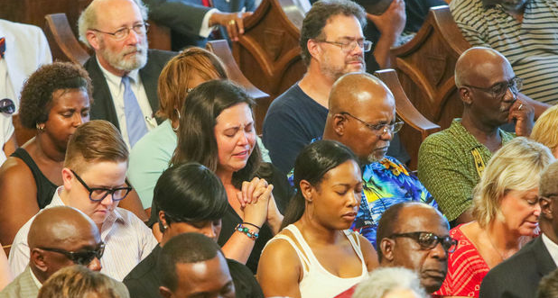 A prayer vigil is held at Morris Brown AME Church for the nine people who were killed by a gunman in Emanuel AME Church on June 18, 2015 in Charleston, S.C. (Tim Dominick/The State/TNS)