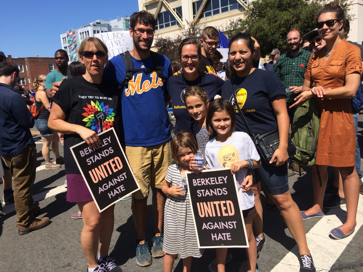 Family and friends with their Berkeley Stands United Against Hate signs.