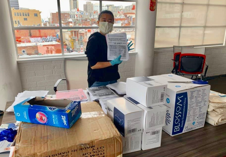Chinese Progressive Association volunteer assembles care packages for residents in the Single Resident Occupancy hotels in SF Chinatown. Photo from CPA-SF website.