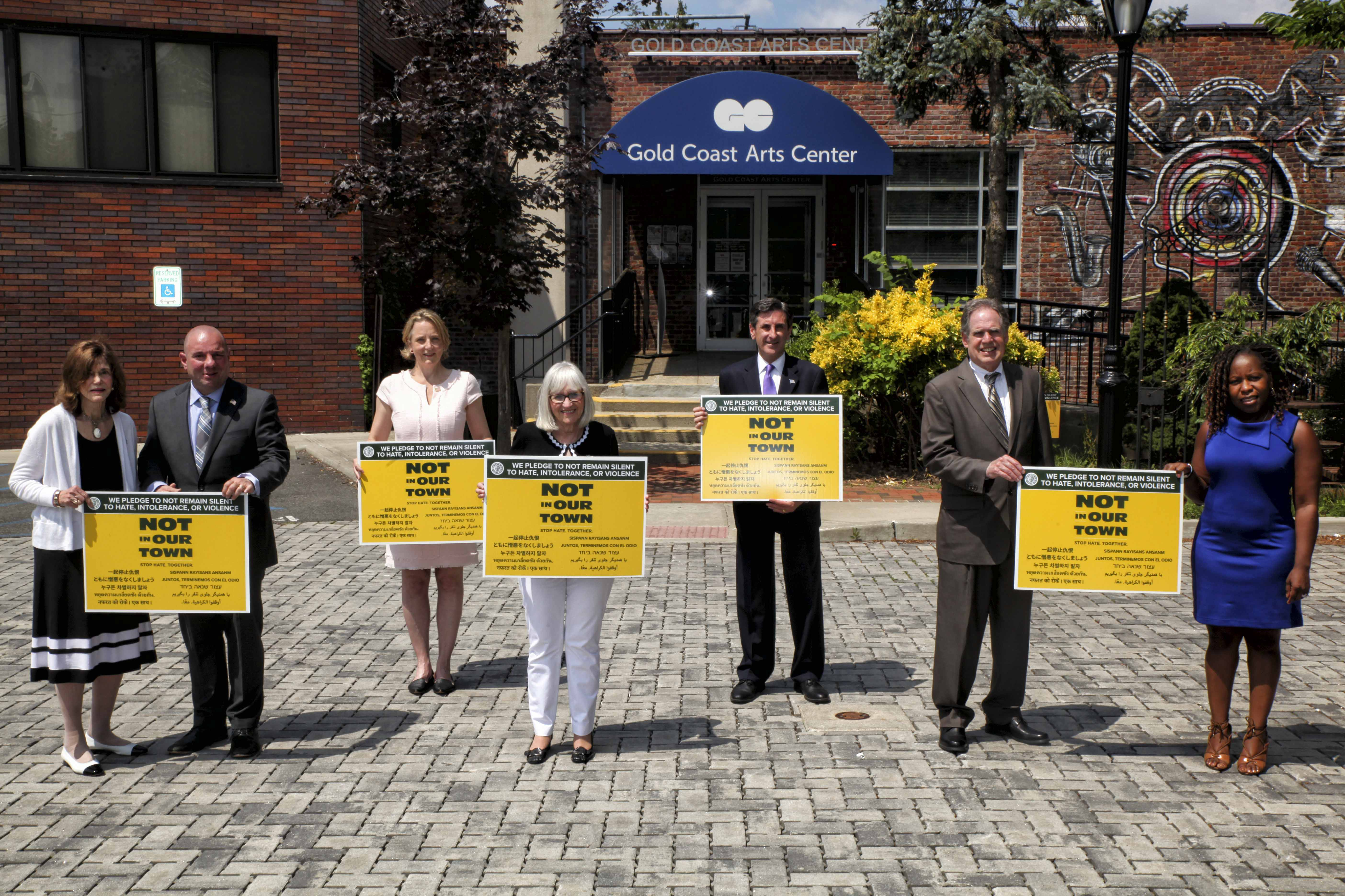 """The lawn signs feature the """"Not In Our Town"""" initiative and messages to stop hate in: Arabic, Chinese, Farsi, Haitian Creole, Hindi, Hebrew Japanese, Korean, Spanish, and Thai."""
