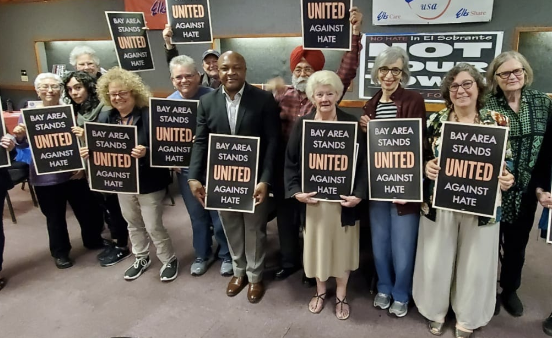 """Community members holding """"Bay Area Stands United Against Hate"""" in West Contra Costa County, CA"""