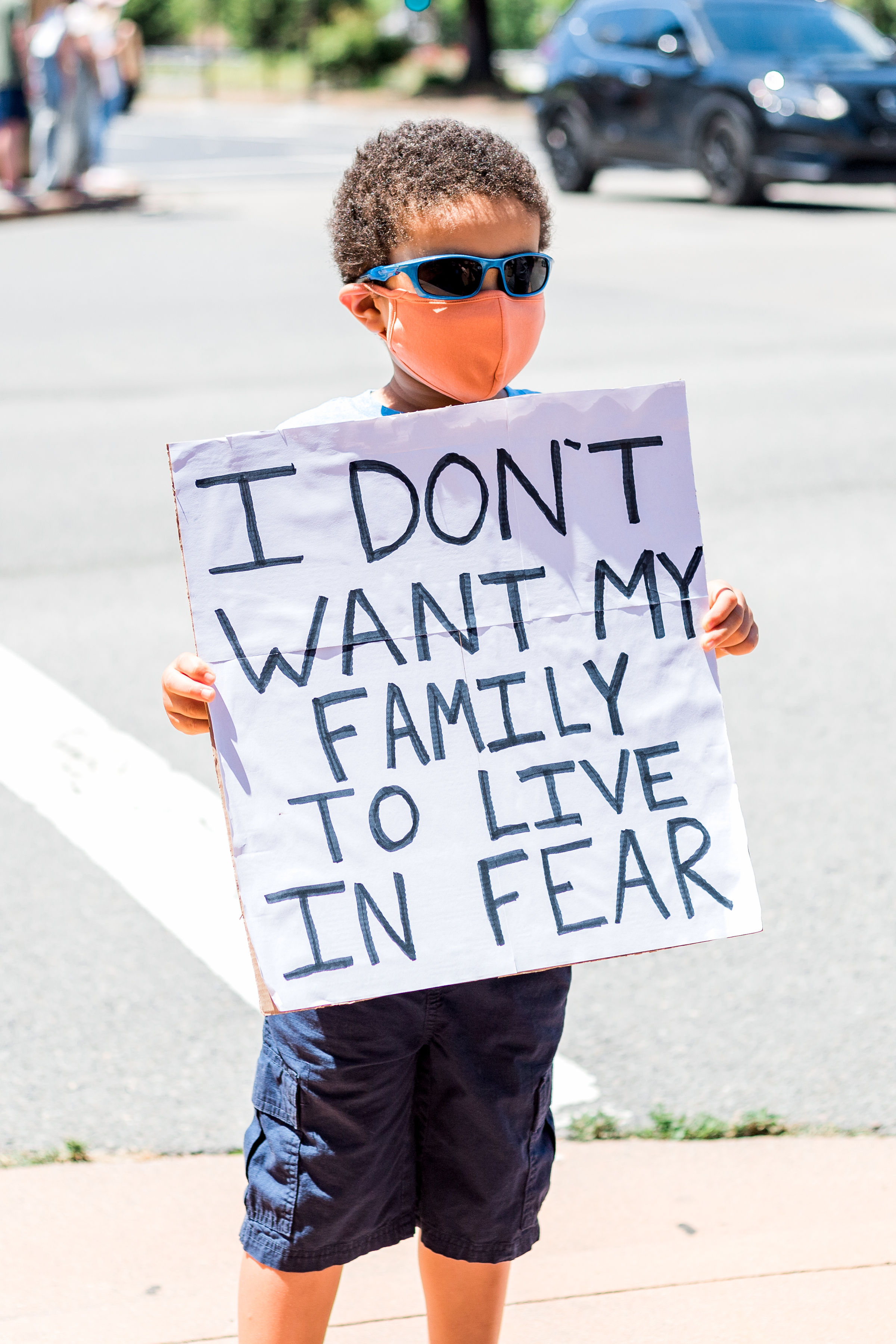 Boy with sign 'I don't want my family to live in fear' Credit: Maya G Photography, Novato BLM Protest