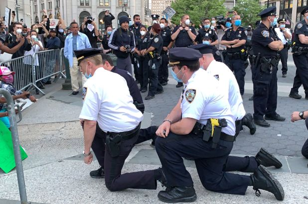 NYPD police chief takes a knee with protesters.