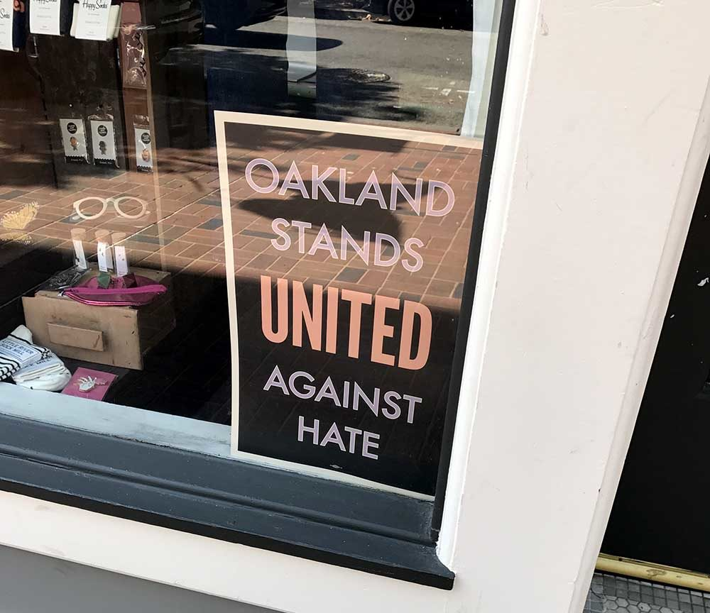 Twitter photo of 'Stand Against Hate' sign in store window.
