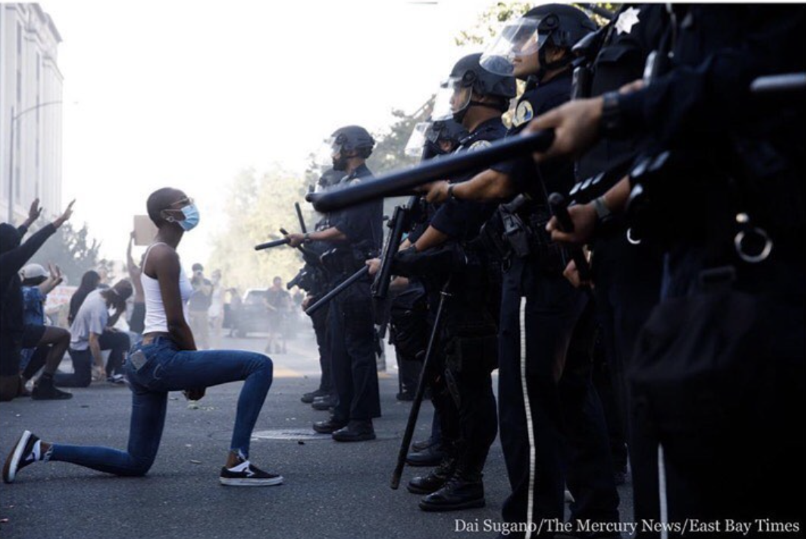 A protester takes a knee during a San Jose protest on Friday after George Floyd's death in Minneapolis.