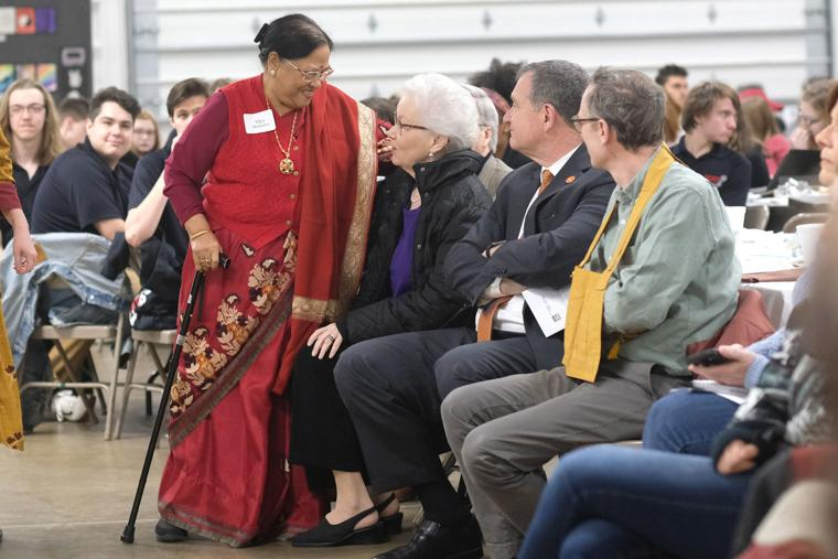 Vijaya Shrestha (left) talks with Nadine Edwards before Shrestha spoke on a panel during the annual Community Interfaith Breakfast at the Wood County Fairgrounds Tuesday morning.