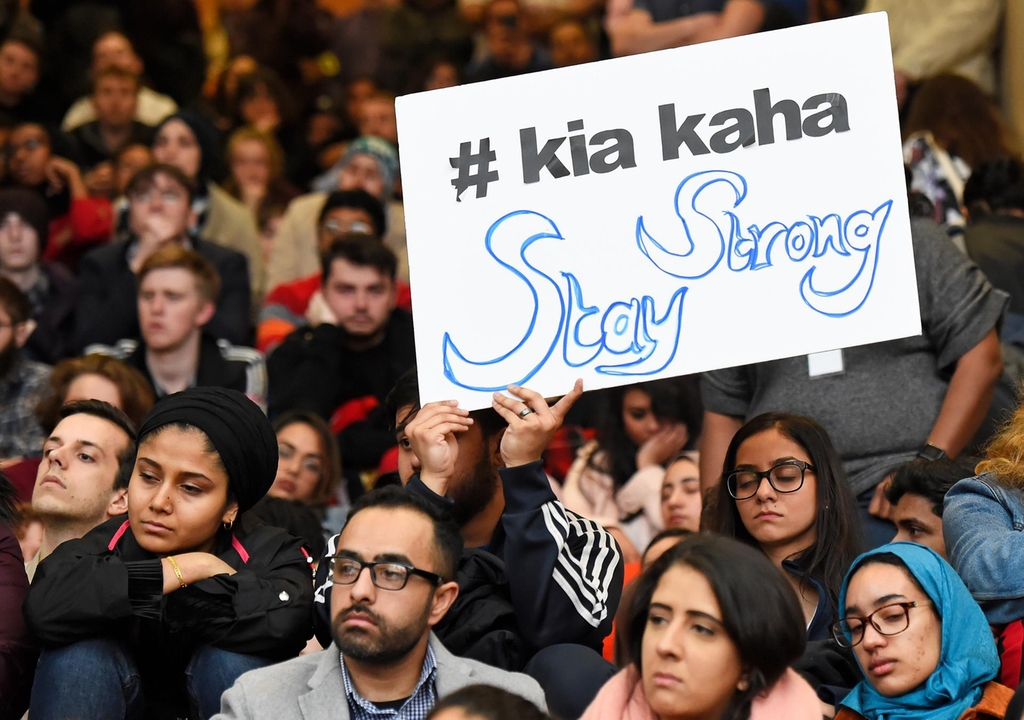 "A man holds a sign at a vigil held at NYU Kimmel Center, New York. Reuters (""Kia kaha"" is Maori for ""stay strong"".)"