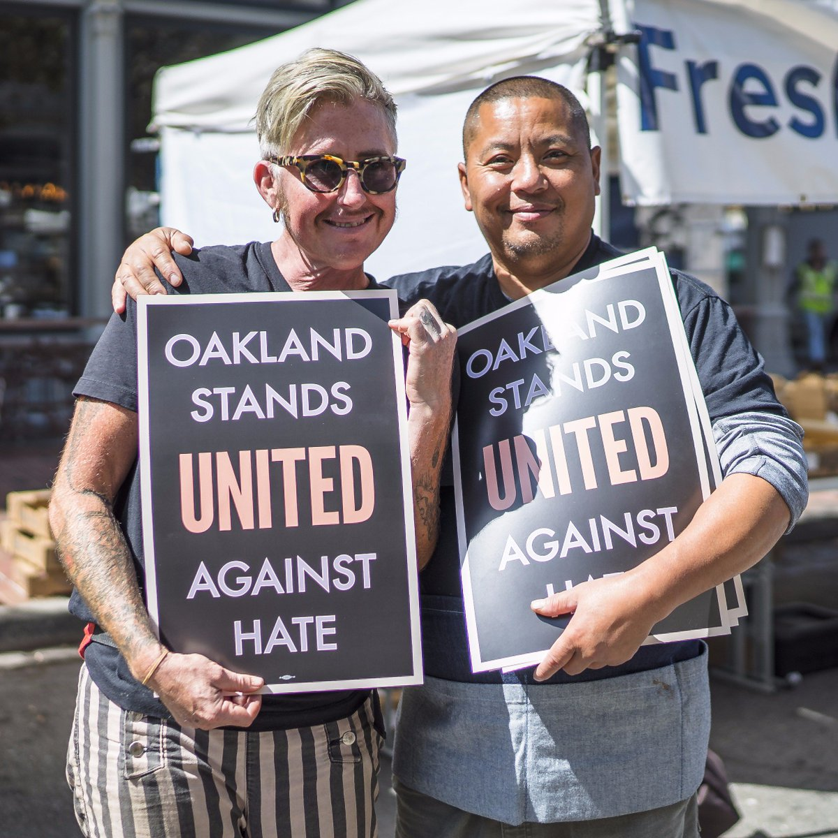 Twitter photo of East Bay residents holding 'Stand Against Hate' signs.