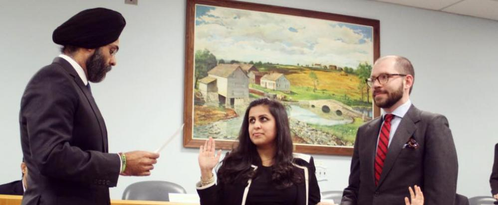 Sadaf Jaffer (center) is being sworn in as Mayor of Montgomery Township by New Jersey Attorney General Gurbir Grewal on January 3, 2019.