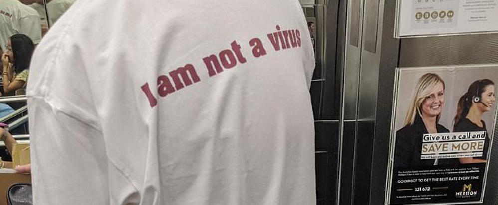 Man wearing an I Am Not a Virus t-shirt