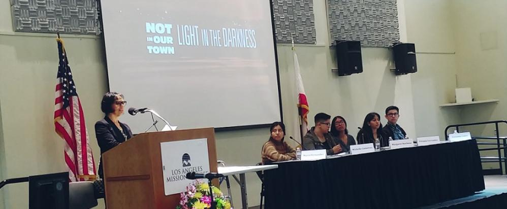 Event co-chair, Commissioner Irma Beserra Núñez, introduces the student panel at the NIOT screening.