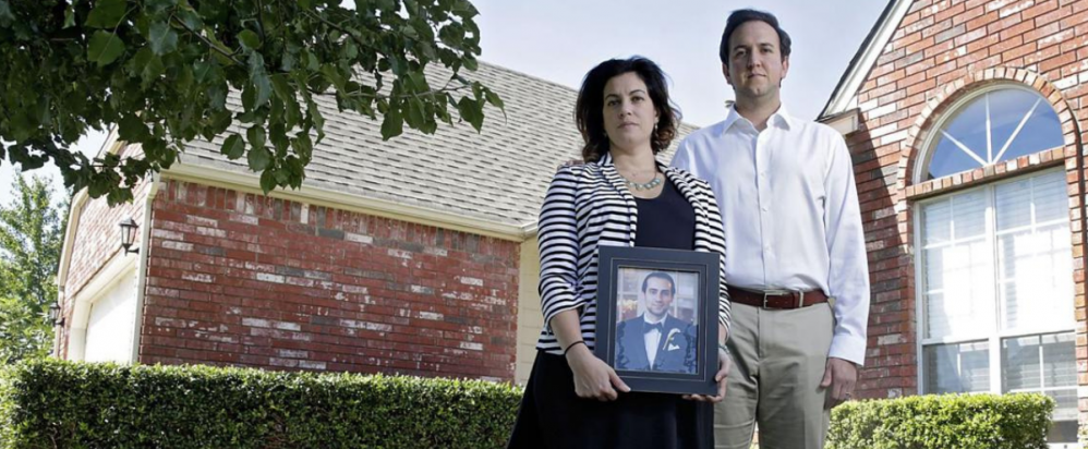Victoria and Rami Jabara with a picture of their brother, Khalid Jabara (Credit: Tulsa World)