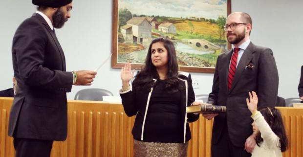 Sadaf Jaffer (center) is being sworn in as the new mayor of Montgomery Township by New Jersey Attorney General Gurbir Grewal on January 3, 2019.