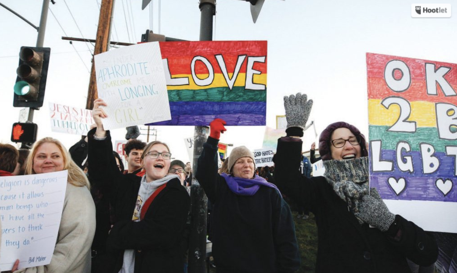 A crowd of 150 or more gather across the street from Thousand Oaks High School at 6:30 a.m. Monday to show their support for the LGBTQ community. RICHARD GILLARD/Acorn Newspapers