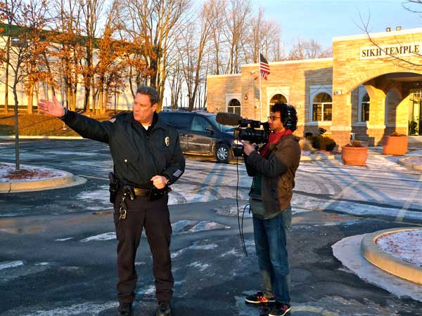 Oak Creek Police Chief John Edwards with photographer Dinesh Sabu at Oak Creek, Wisconsin Sikh Temple